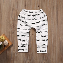 "Adorable 2 piece top and pant set with ""Mr Little Boss"" printed long sleeve shirt and moustache print pants. Perfect for between seasons."