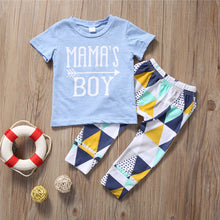 "Blue ""Mama's Boy"" printed t-shirt with funky pants."