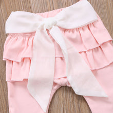 Gorgeous pink pants with a frilled tutu bottom and bow.