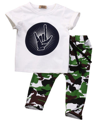 Cheeky Shaka Print T-Shirt with camouflage print pants.