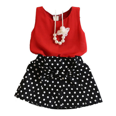 Fashionable sleeveless vest top with dot skirt.