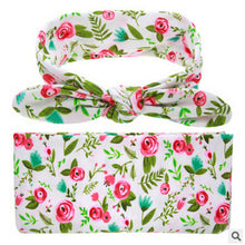 Floral Soft easy to swaddle infant blanket wrap with matching bowknot headband.