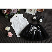 Gorgeous white detail blouse with a black tutu skirt