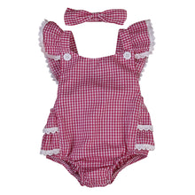 Adorable, red plaid romper with matching headband.