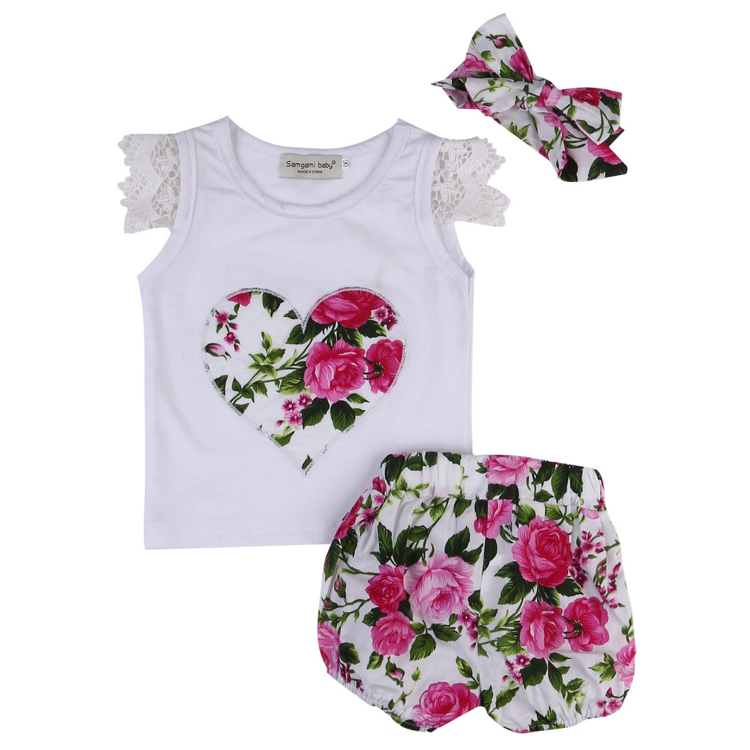 Pink gorgeous with floral shorts, matching bow headband and heart print top
