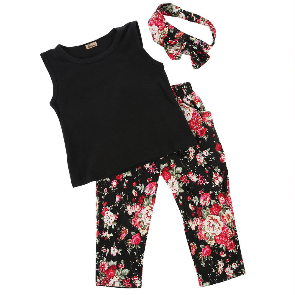Black sleeveles t-shirt, floral pants with matching headband