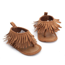 Gorgeous girls leather tassel flat heeled sandal.