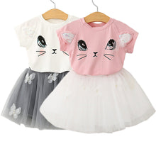 Adorable kitty printed top with butterfly tutu skirt.