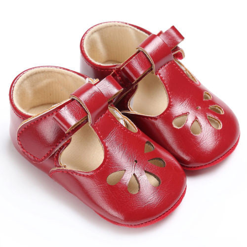 red Sweet baby girl summer shoes with flat heel.