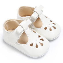 white Sweet baby girl summer shoes with flat heel.