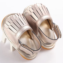 gold Trendy Summer tassel sandals with flat heel.