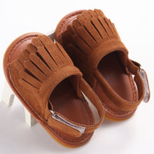coffee Trendy Summer tassel sandals with flat heel.