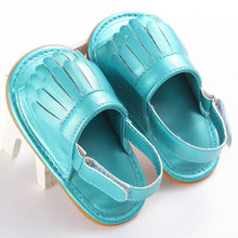 Light blue Trendy Summer tassel sandals with flat heel.