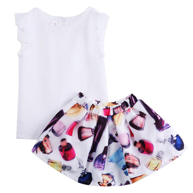 Gorgeous white sleeveless top with ruffled shoulders and a printed skirt