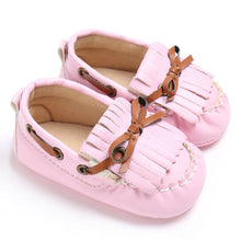 pink Beautiful Moccasin Prewalker shoes with leather lace details and fringe front.