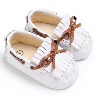 white Beautiful Moccasin Prewalker shoes with leather lace details and fringe front.