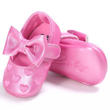Gorgeous baby girls first walker shoes with beautiful bow and heart pattern.