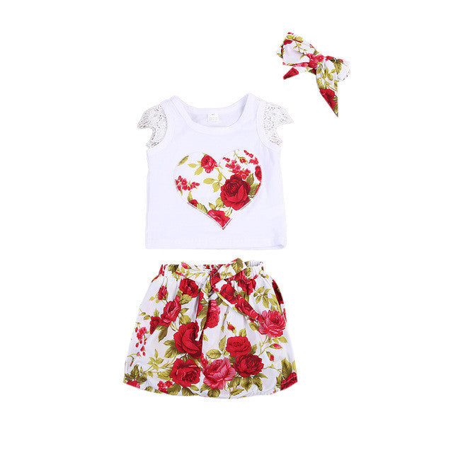Gorgeous outfit that includes a white sleeveless t-shirt with lace shoulders and red floral heart print, matching floral shorts and headband