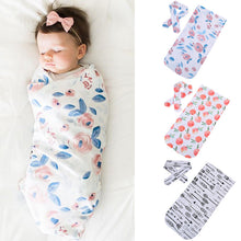 Soft easy to swaddle infant blanket wrap with matching headband.