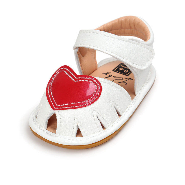 white Beautiful Summer girls shoes with anti-skid sole and heart feature.