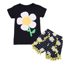 Very cute girls black daisy print T-shirt with matching polka dot and daisy print shorts with yellow tassels