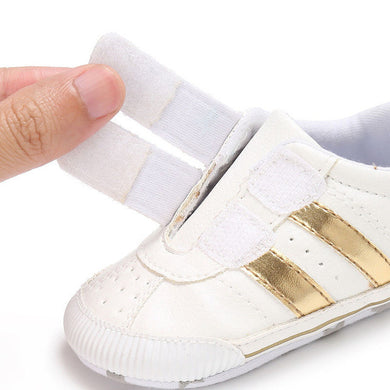 gold stripe Boys and Girls funky sneaker perfect for those first steps.