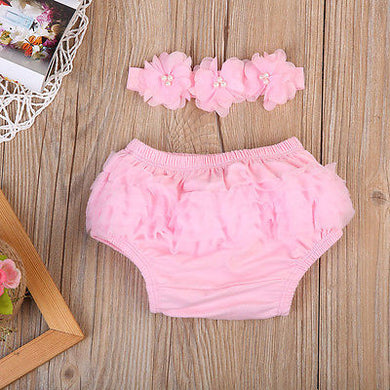 Adorable pink lace bloomers with matching floral headband.