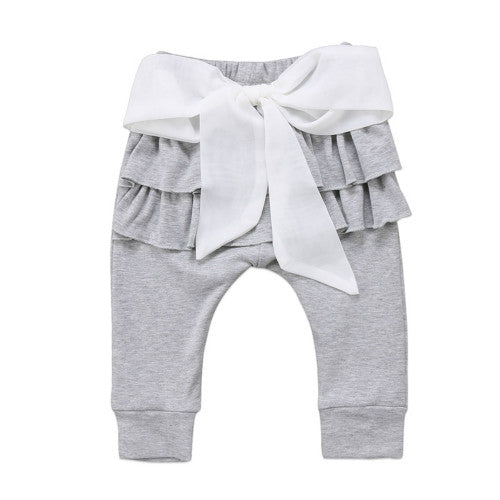 Gorgeous grey pants with a frilled tutu bottom and bow.