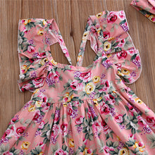 Pink stylish backless floral sundress with matching headband.