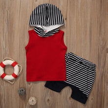 Funky sleeveless hooded top with adorable matching shorts.