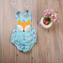 Gorgeous teal green backless romper with a foxy print.
