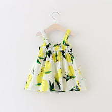 Gorgeous light sleeveless summer dress with decorative bow and lemon print.