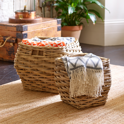 Lifestyle image of Valiant Kelshall and Barkway log baskets on lounge floor, filled with blankets and throws
