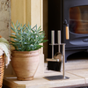 Lifestyle image Valiant brushed steel Petite Companion Set next to a wood burning stove
