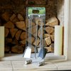 Lifestyle image of Valiant Salisbury Glass Companion Set on a hearth with logs