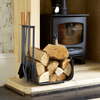 Lifestyle image of Valiant Warwick Companion Set filled with logs next to fireplace with wood burning stove
