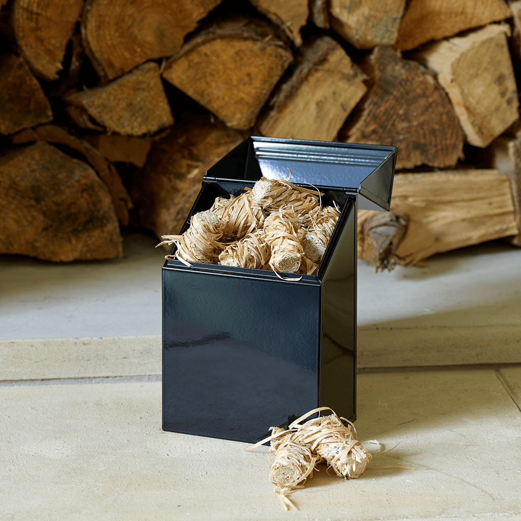 Valiant Firelighter Tidy open, filled with eco-friendly firelighters, sitting on hearth with logs