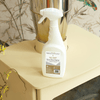 Lifestyle image of Valiant Stove Glass Cleaner sitting on top of a wood burning stove