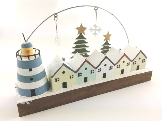 Christmas row of houses and blue lighthouse