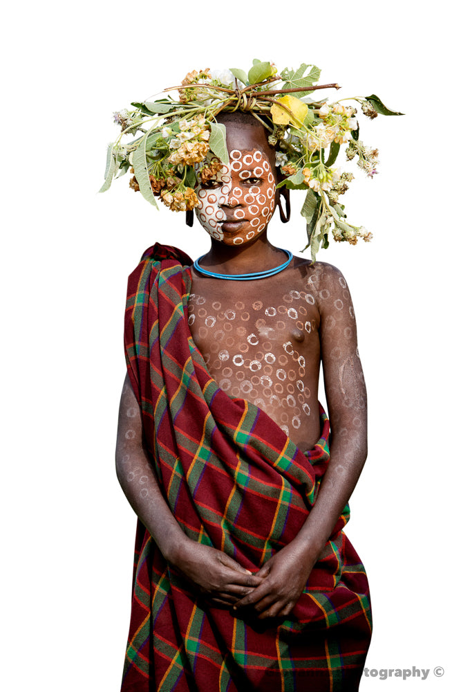 IMANI - Young Suri boy with yellow flowers