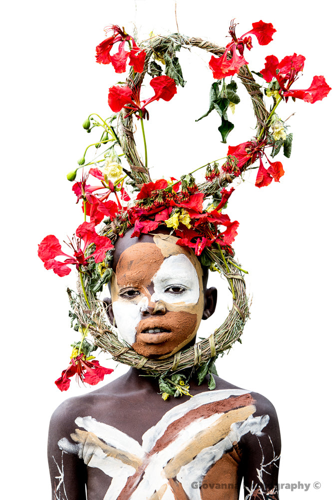 MELAKU - Young Suri boy with red flowers