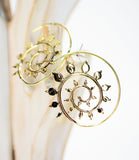 Brass Spiral Earrings with Tiny Leaves - edocollection