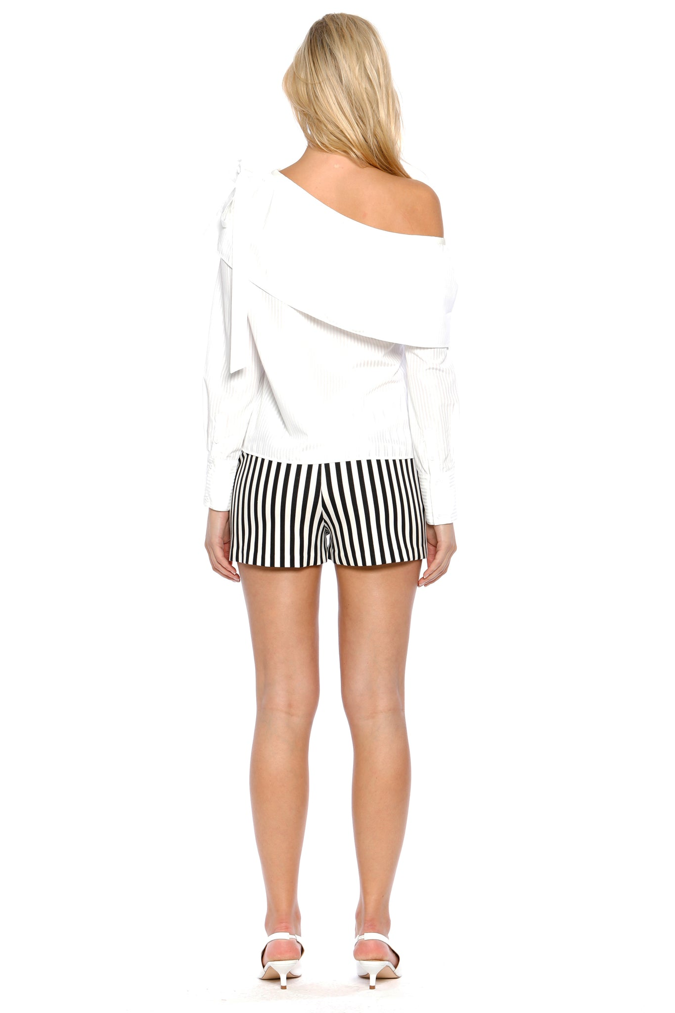 Back view of Jeanne Short, black-and-white-striped short shorts with frilled pockets. 60% Rayon, 35% Nylon, and 5% Spandex - and Machine-washable.