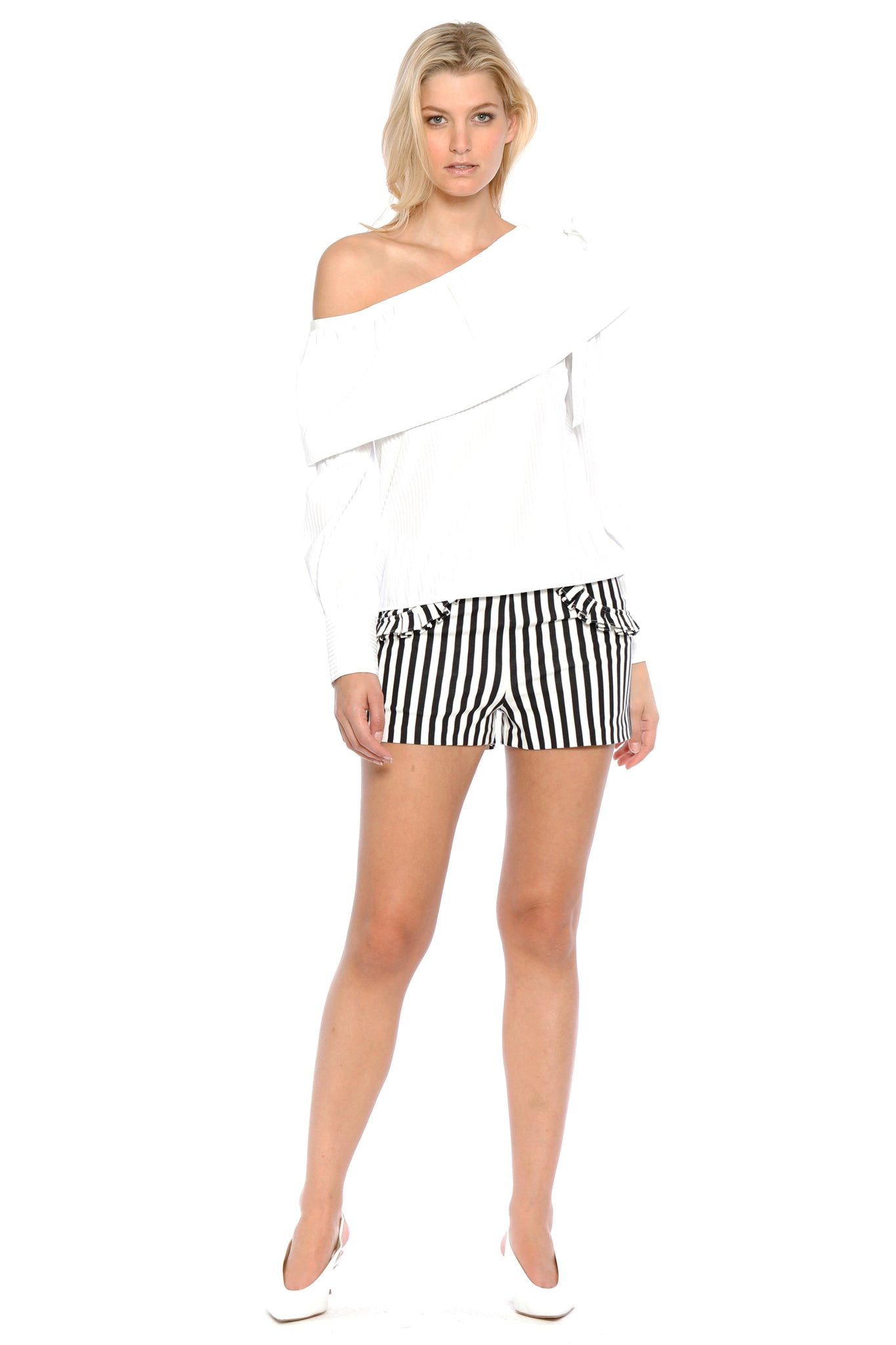 Front view of Jeanne Short, black-and-white-striped short shorts with frilled pockets. 60% Rayon, 35% Nylon, and 5% Spandex - and Machine-washable.