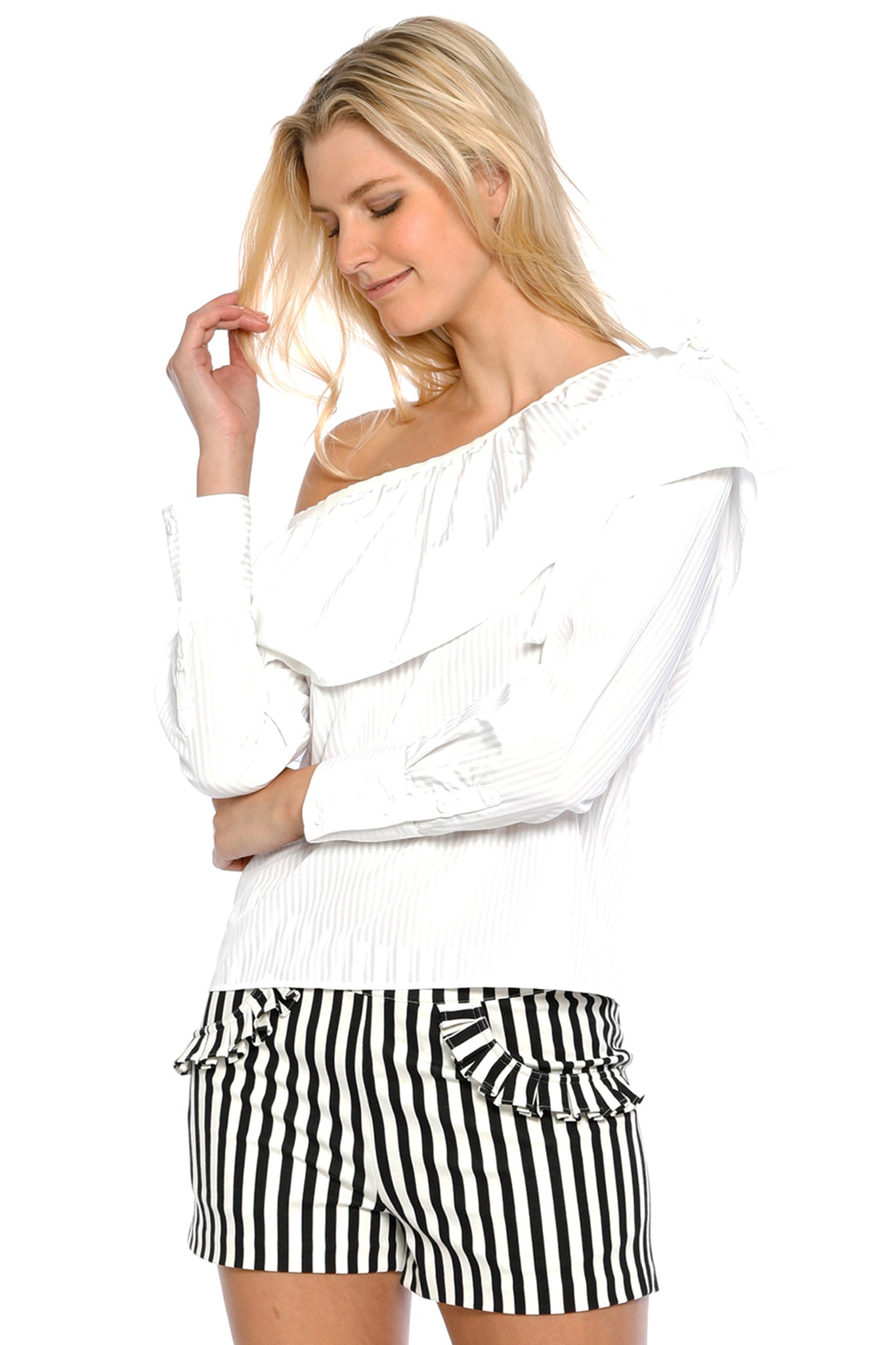 Front view (pose) of Jeanne Short, black-and-white-striped short shorts with frilled pockets. 60% Rayon, 35% Nylon, and 5% Spandex - and Machine-washable.