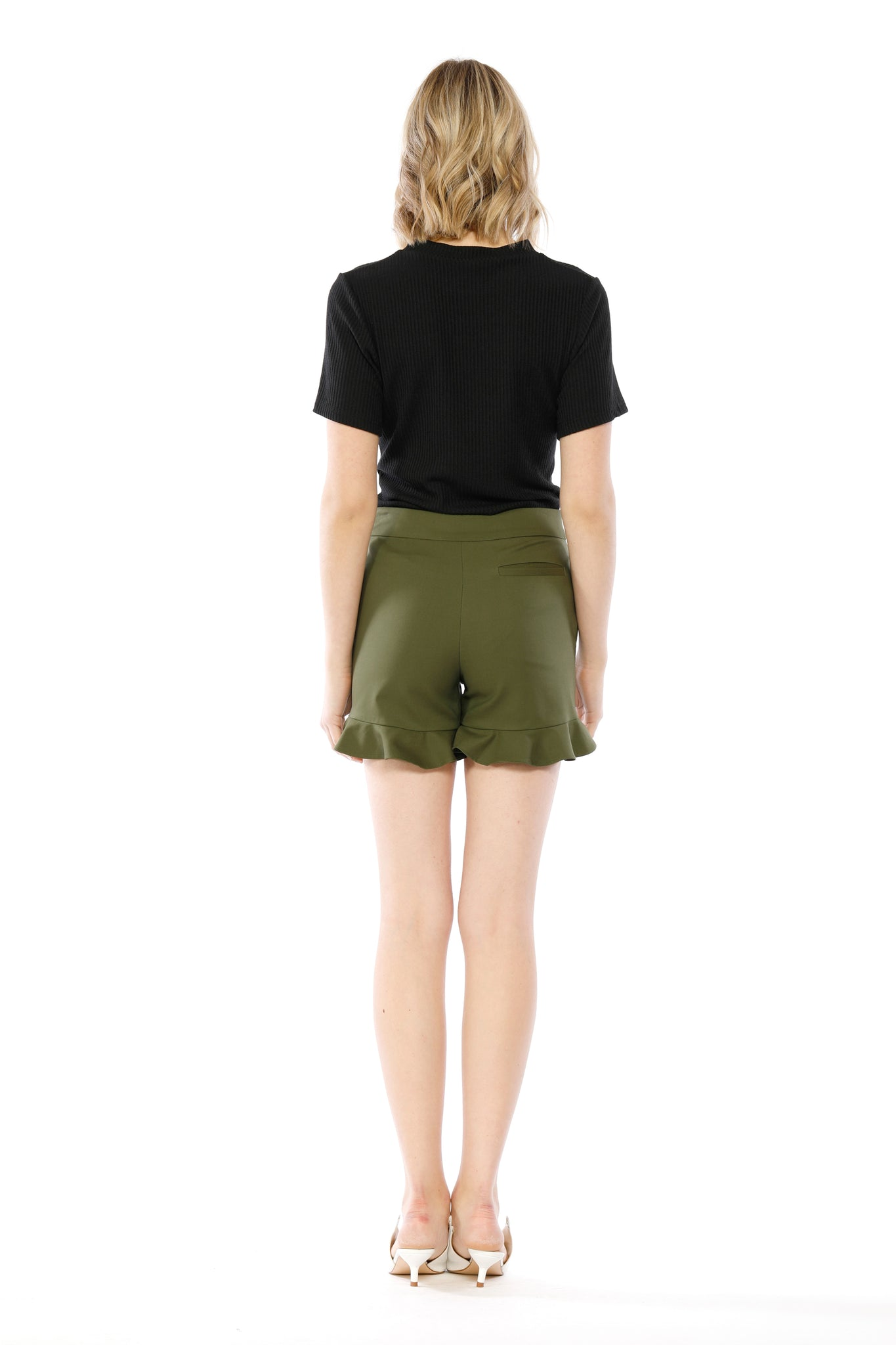 Back view of Lillian Short, sleek olive short shorts with flared, ruffled bottoms. Shell is 95% Cotton and 5% Spandex, Lining is 80% Polyester and 20% Cotton - and Machine-washable.