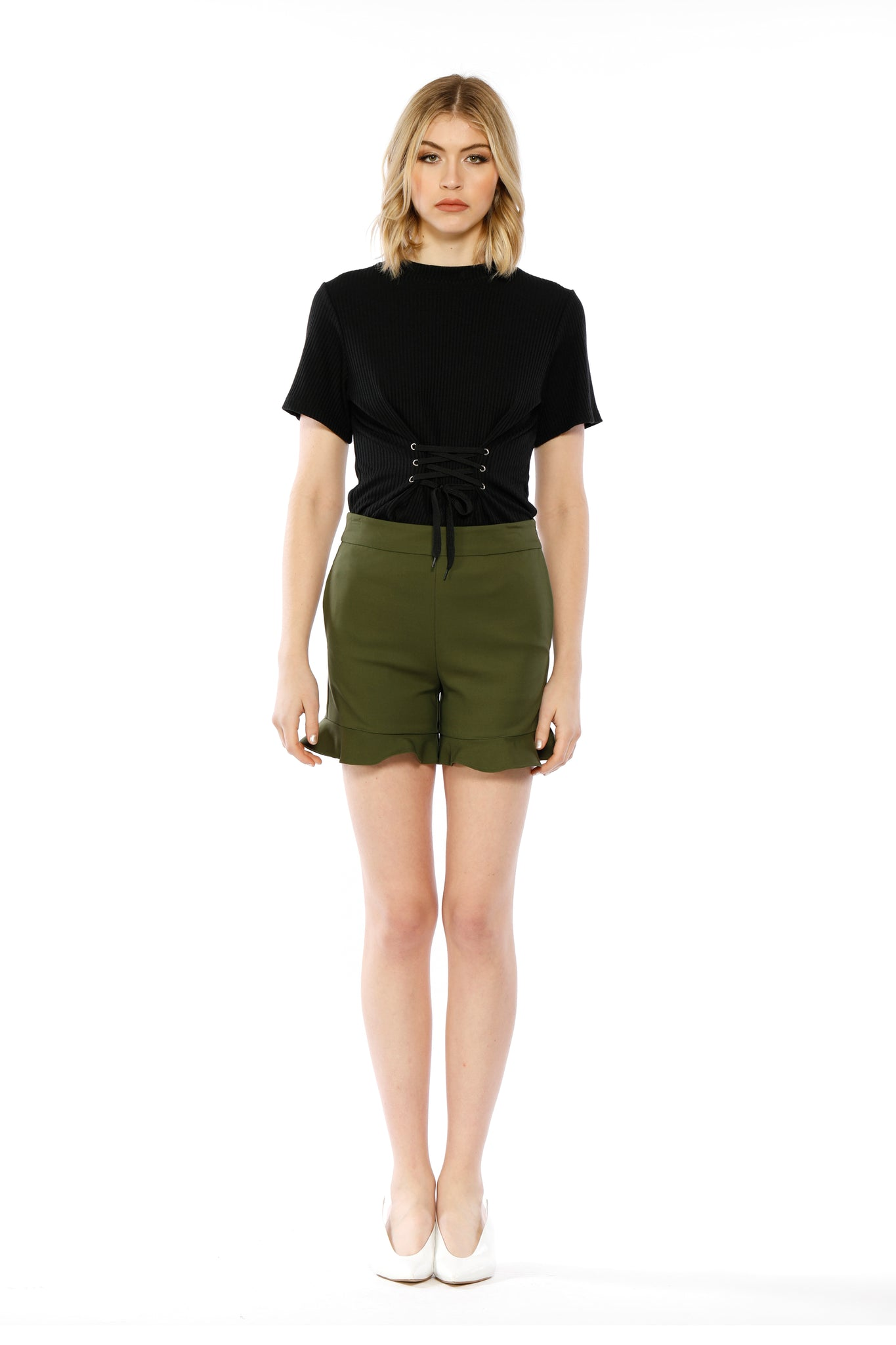 Front view of Lillian Short, sleek olive short shorts with flared, ruffled bottoms. Shell is 95% Cotton and 5% Spandex, Lining is 80% Polyester and 20% Cotton - and Machine-washable.