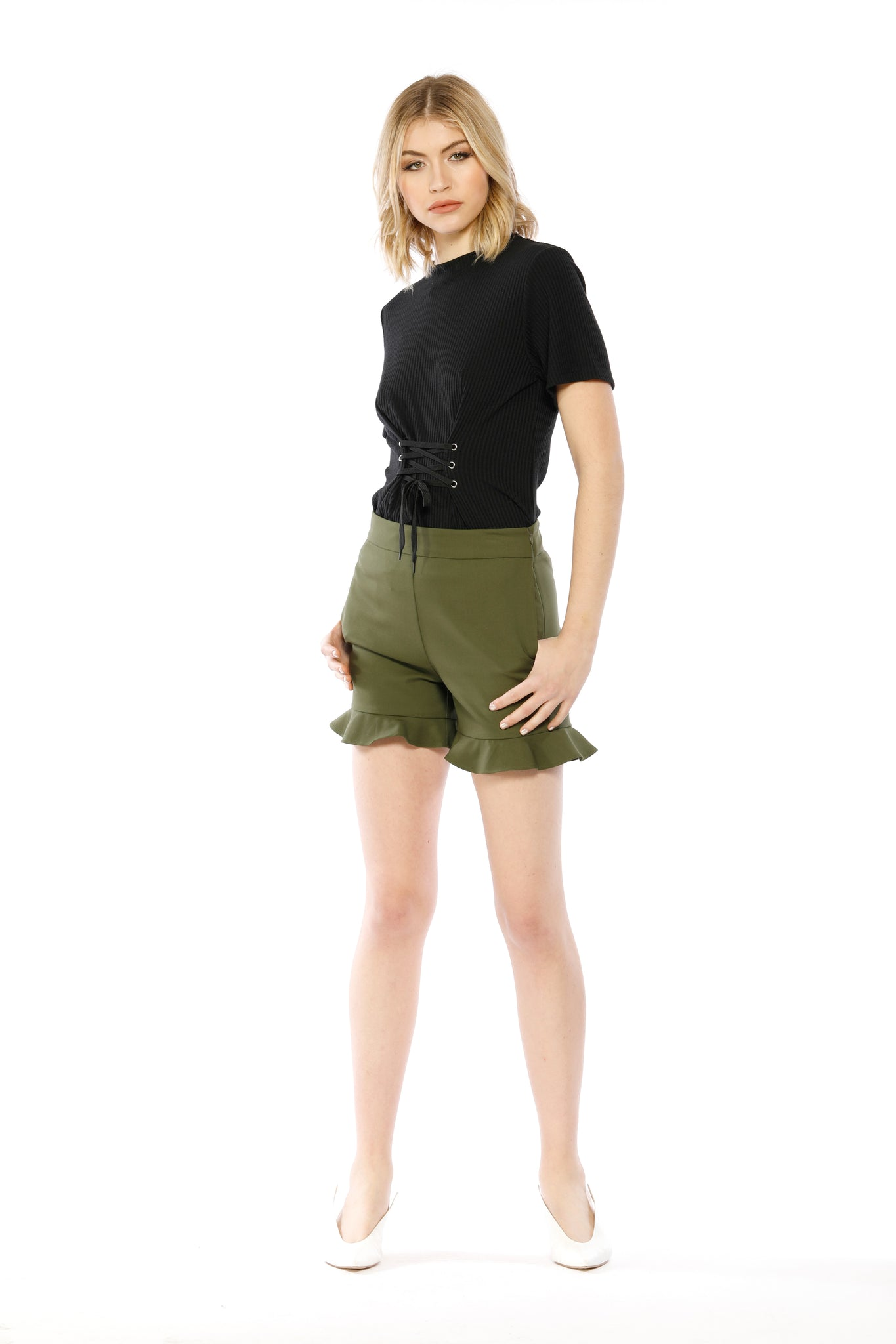 Front view (pose) of Lillian Short, sleek olive short shorts with flared, ruffled bottoms. Shell is 95% Cotton and 5% Spandex, Lining is 80% Polyester and 20% Cotton - and Machine-washable.