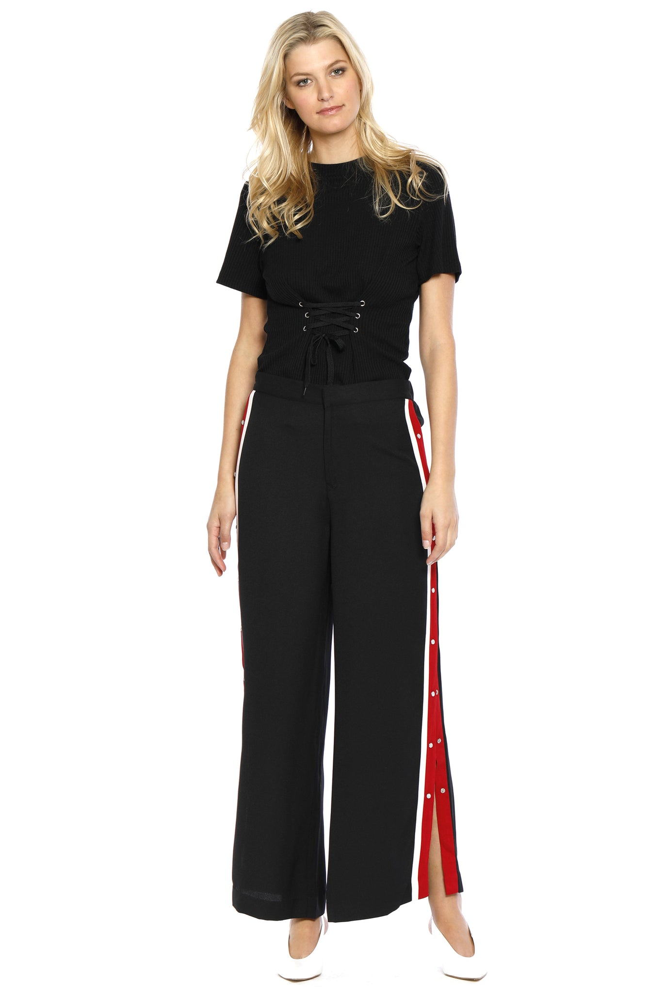 Front view of Maxine Pant, black retro pants with buttons on the side and a red stripe outlined with white borders on both sides, 100% Polyester and Machine-washable.