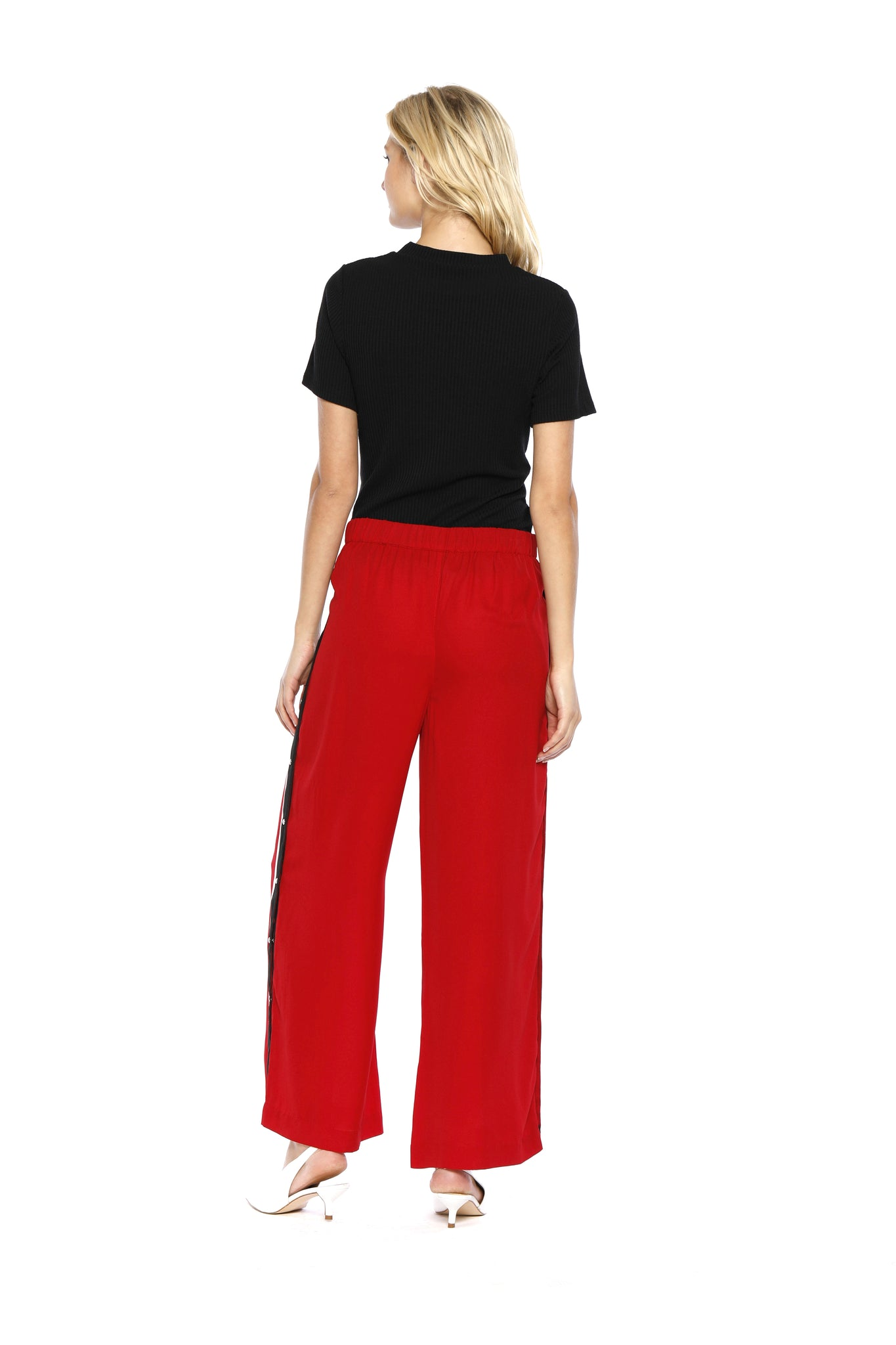 Back view of Maxine Pant, red retro pants with buttons on the side and a black stripe outlined with white borders on both sides, 100% Polyester and Machine-washable.